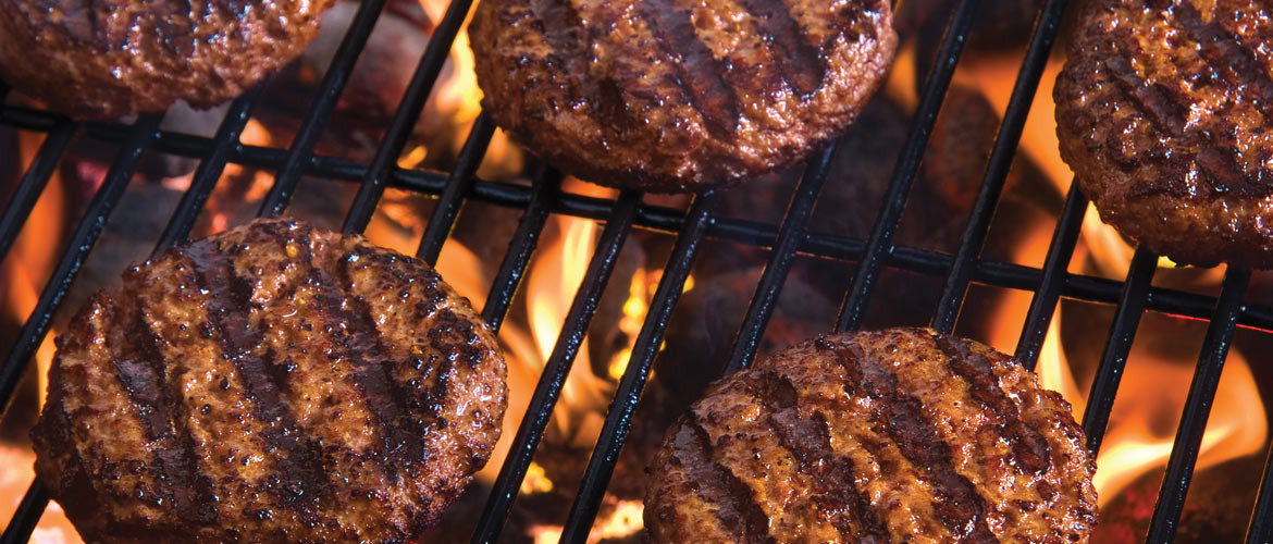 photo of burgers grilling